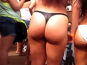 Dancing asses on an after beach party
