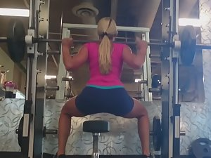 Fitness girl exercises legs and ass