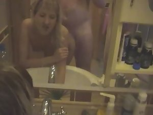 Sex in front of the bathroom mirror