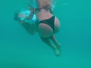 Asian ass spied from underwater