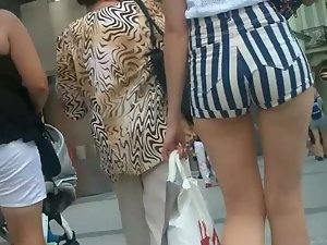 Tall sexy daughter shopping with mother