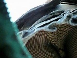 Fishnet stockings seen in an upskirt