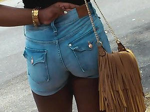 Ghetto girl in booty shorts wait for ride