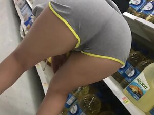 Wet spot on her pussy in cotton shorts