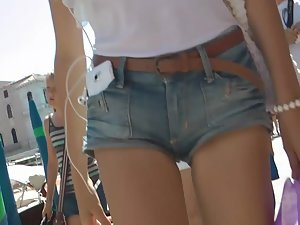 Innocent looking girl in tiny shorts
