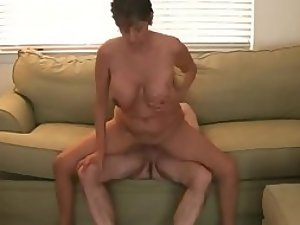 Hot busty milf rides a dick on the sofa