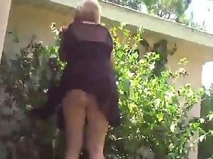 Upskirt of neighbor trimming the bushes