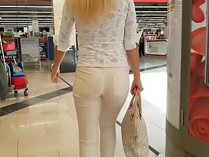 Sexy figure of blonde in all white outfit
