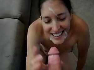 Freckled girl sucks and gets cum on face