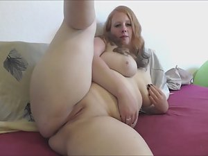 Flexible chubby girl plays with a dildo
