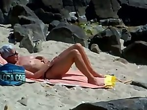 Peeping on a sun tanning woman