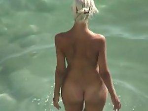Beach nymph gets fucked hard