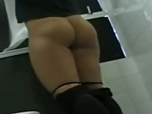 Terrific ass peeped as she pee and wipe