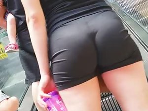 Young milf in tight shorts at the shopping mall