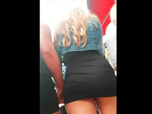 Ass cheeks popping out of minimal black skirt