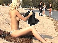 Blonde nudist girl at a beach