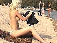 Blonde nudist girl at a beach