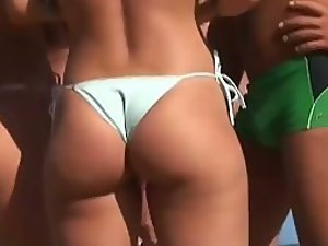Amazing asses wearing thong bikinis