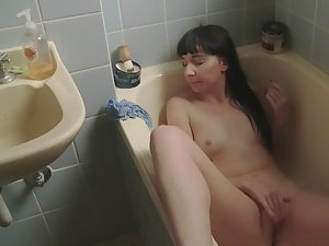 Sweet girl masturbates in the bathtub Picture 1