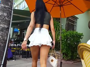 Sexy latina in shorts that looks like skirt