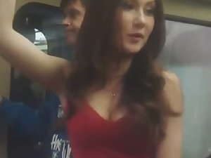 Fancy girl with big boobs inside train