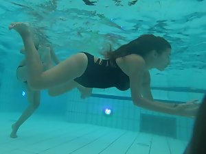 Big young boobs shaking while she swims