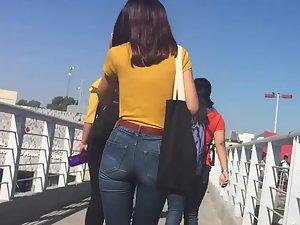 Elegant girl in skinny jeans