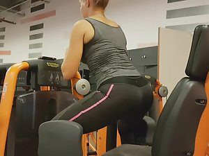 Spying on fit blonde exercising her ass