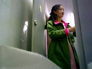 Charming asian girl spied in public restroom