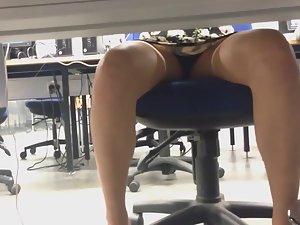Upskirt of schoolgirl in computer class