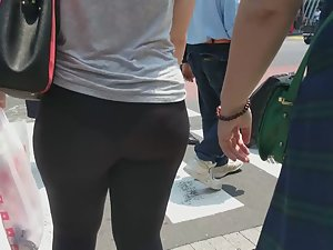 Huge ass in tights and a very visible thong