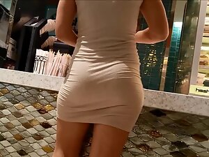Tight dress shows the beauty of her curves