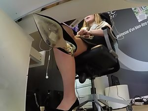 Upskirt of businesswoman under her desk