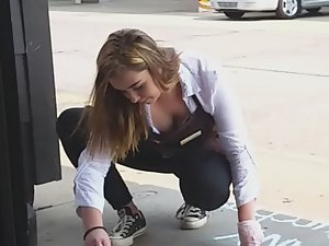 Waitress kneels and her boobs show