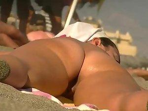 Nicely spread legs on a nudist beach