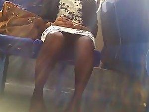 Between commuting woman's legs