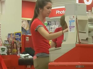 Sexy cashier girl at work