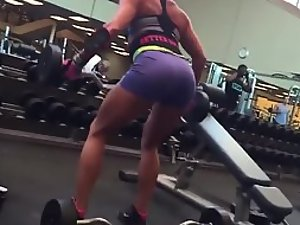 Muscular woman's ass in the gym