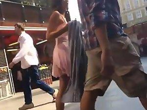 Voyeur peeps on appealing girl's skirt