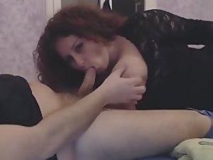 Busty babe sucks a dick and licks it off