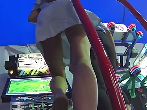 Upskirt of teen girl dancing and playing game