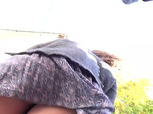 Wind shows brunette's bubble butt in upskirt Picture 7