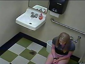 Blonde girl in pees in a public toilet