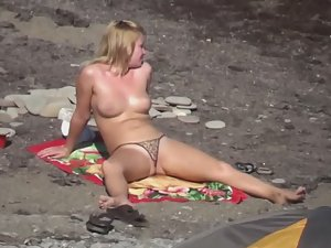 Pussy lips slip from thong bikini Picture 2