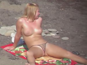 Pussy lips slip from thong bikini Picture 3