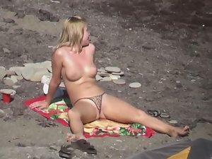 Pussy lips slip from thong bikini
