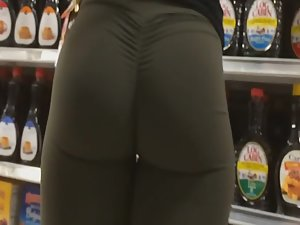 Ultra fit woman buys groceries