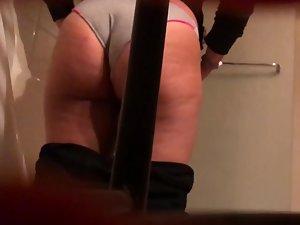 Big naked butt seen through hidden camera in toilet
