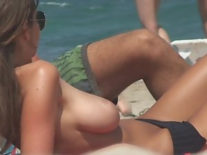 Stunning girl gets naked on beach Picture 3