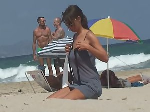 Stunning girl gets naked on beach